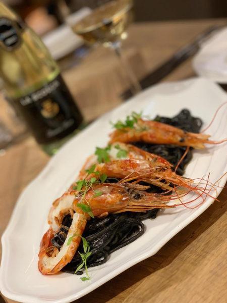 Black ink linguine with red prawns